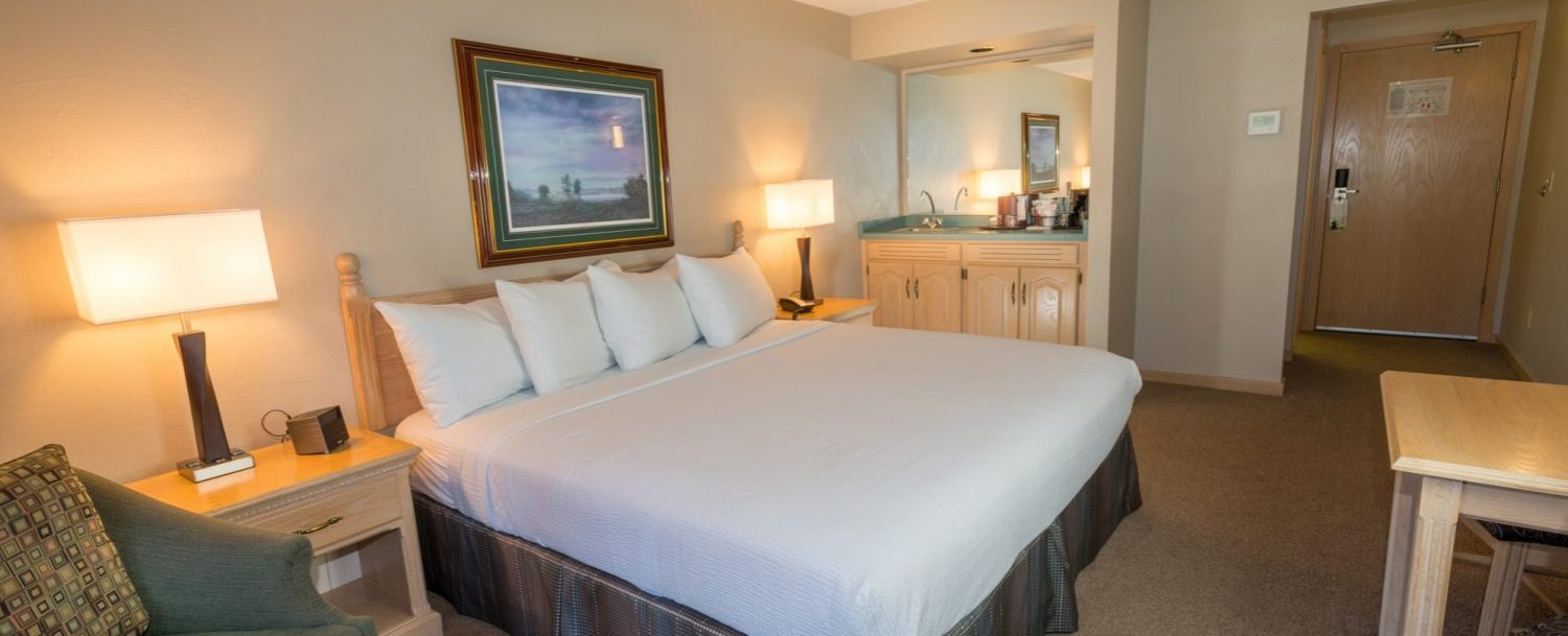 bed and interior of a guest room at The Ashbrooke