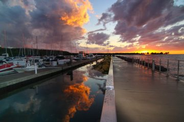 Sky reflection at marina at sunset