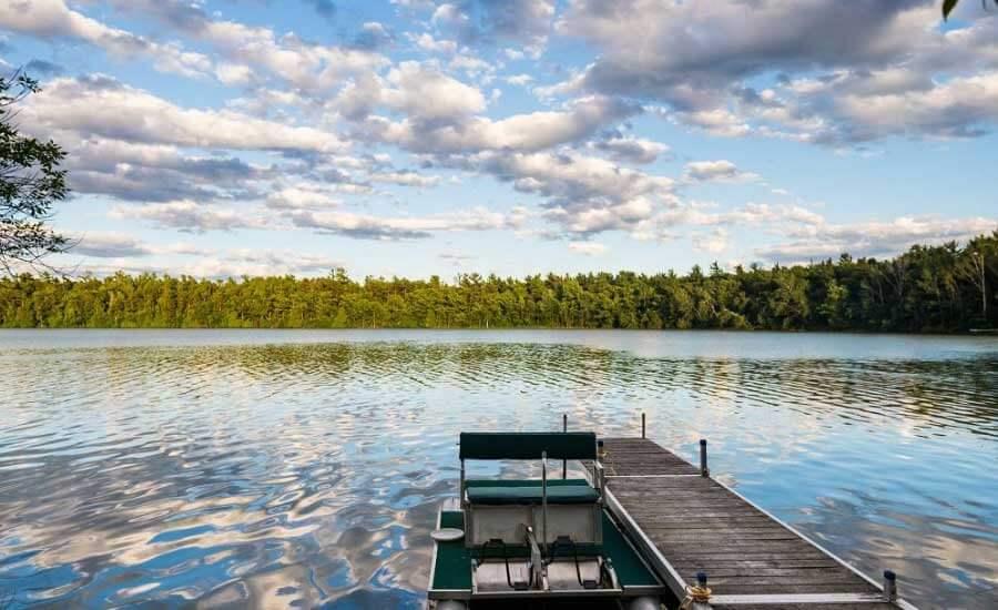 Boat docked on lake