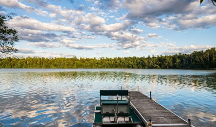 Boat docked in lake