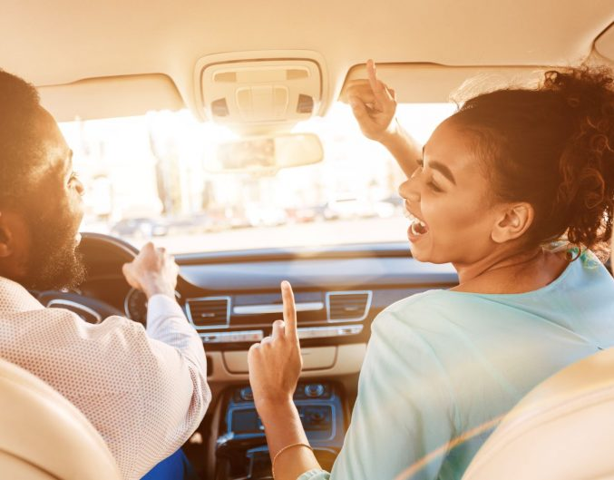 couple traveling in car on road trip